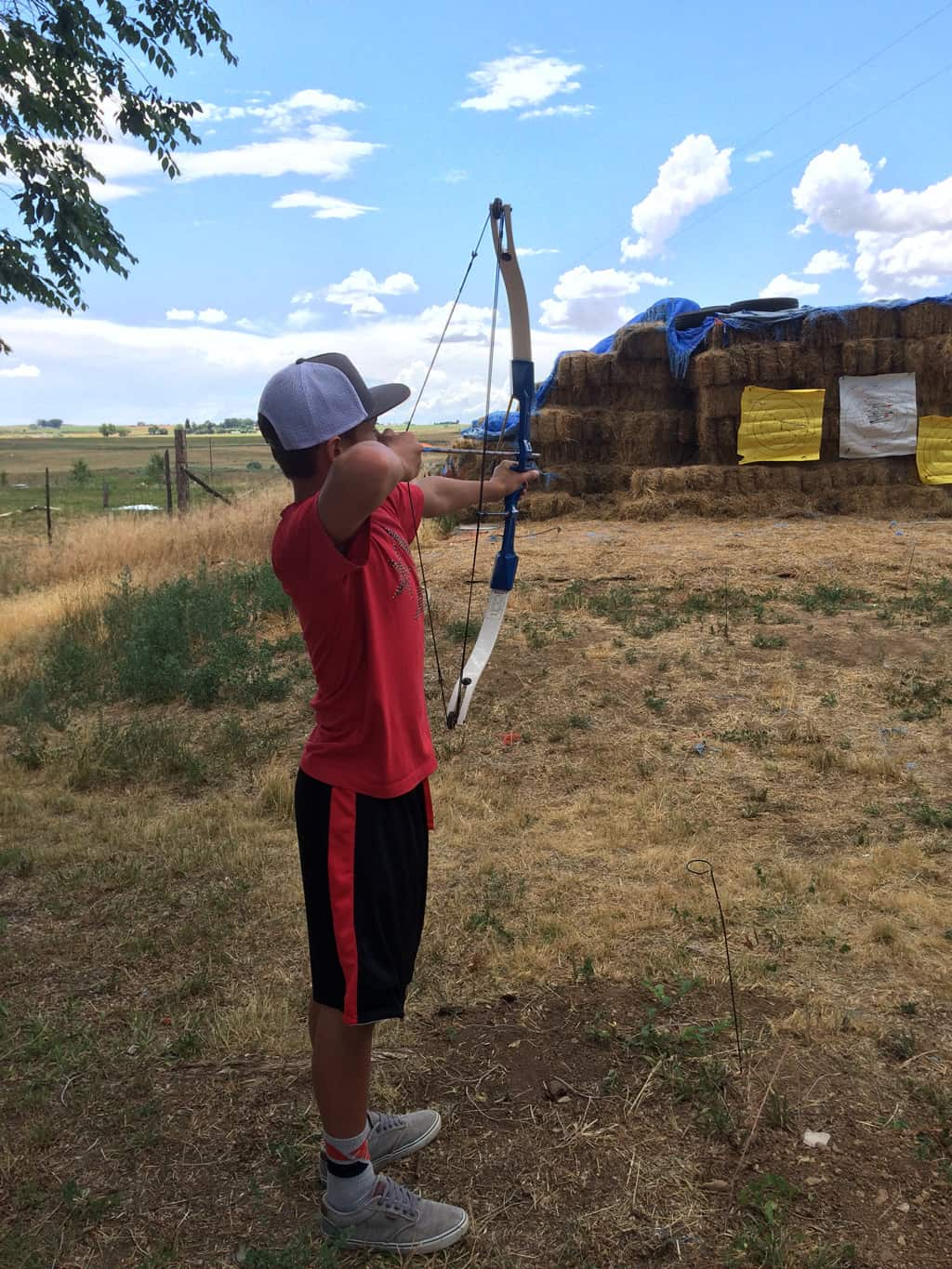 Photo of boy shooting archery.