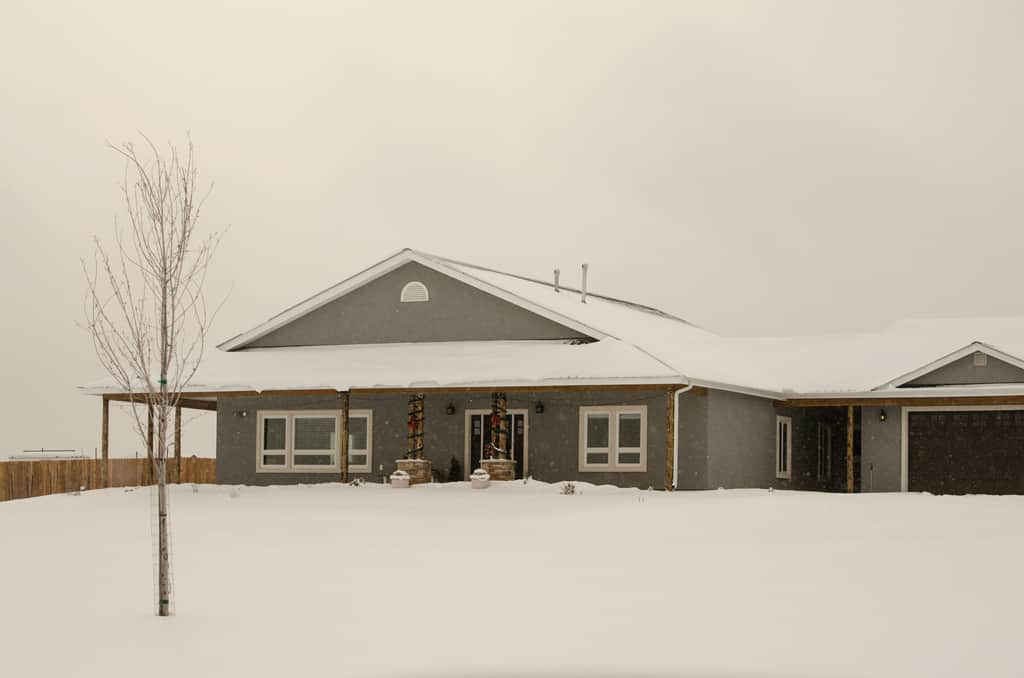 Grey house in snowy scene