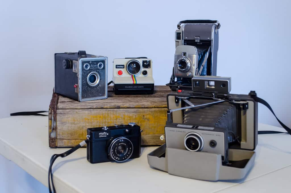 a collection of vintage cameras on a table