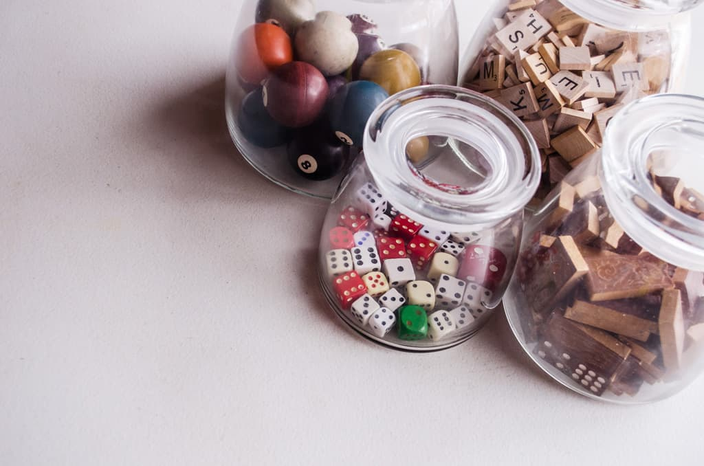old game pieces in jars on a table