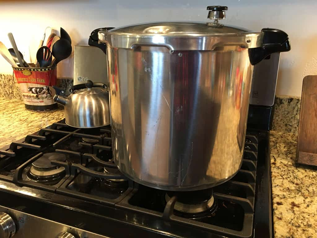 photo of a pressure cooker/canner on a kitchen stove top