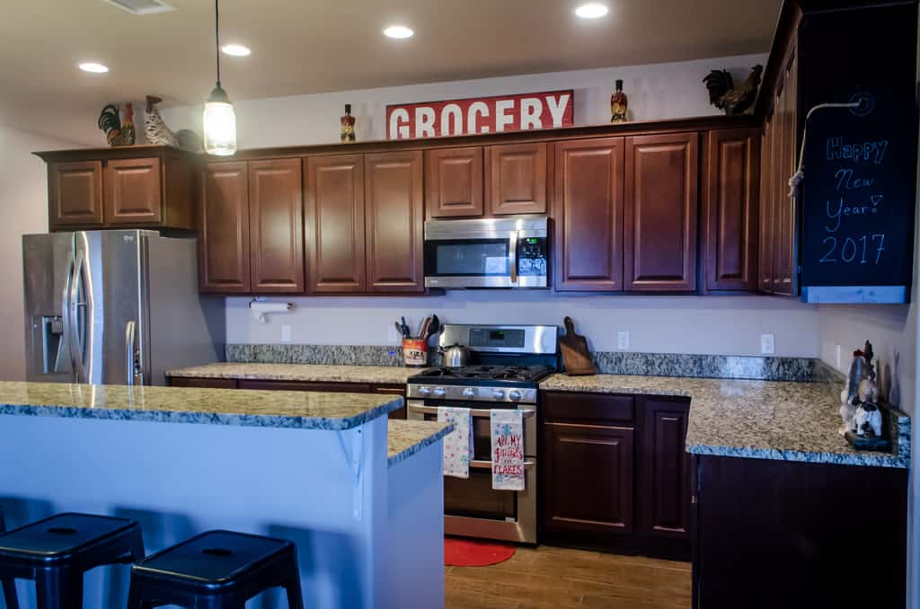 photo of a kitchen with granite countertops and brown cabinets