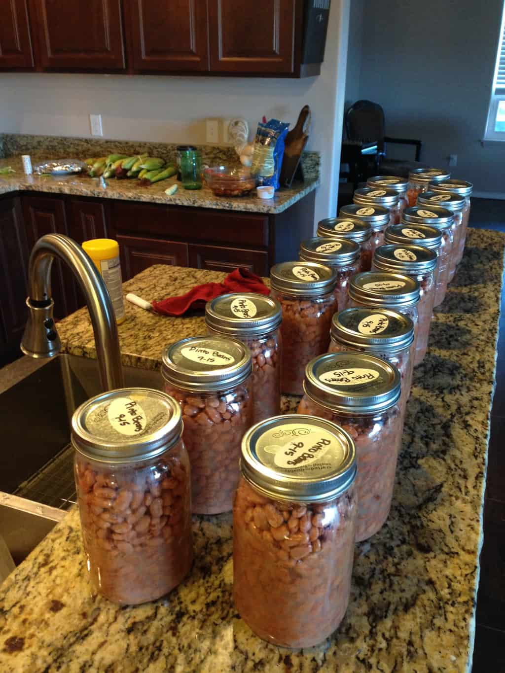 photo of beans canned in mason jars on the kitchen counter