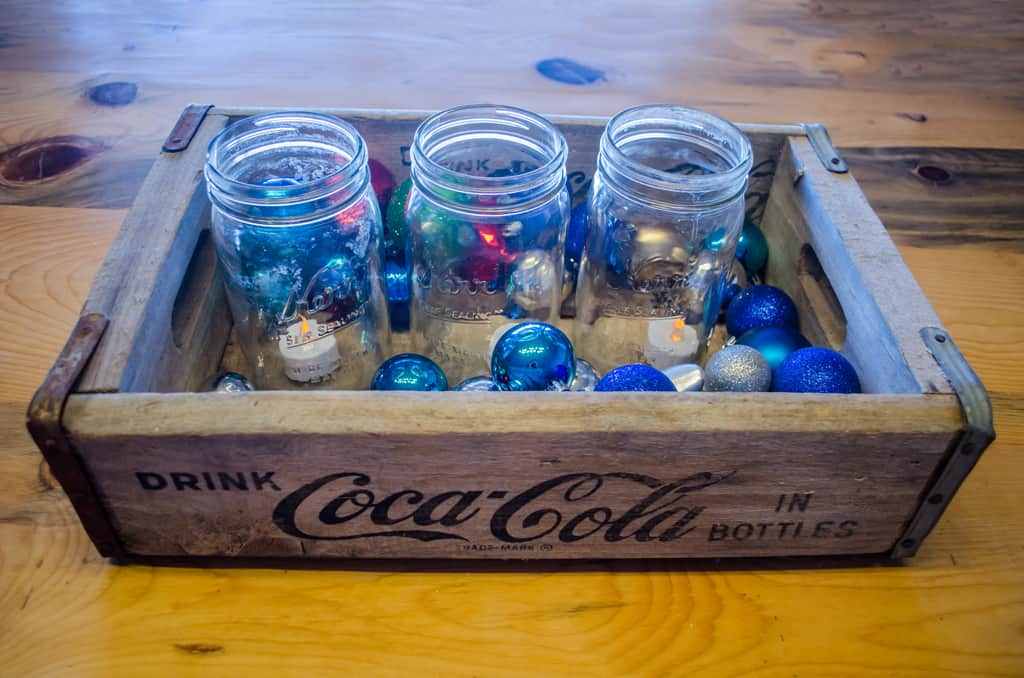 Christmas decoration- coca cola crate with mason jars and ornaments inside