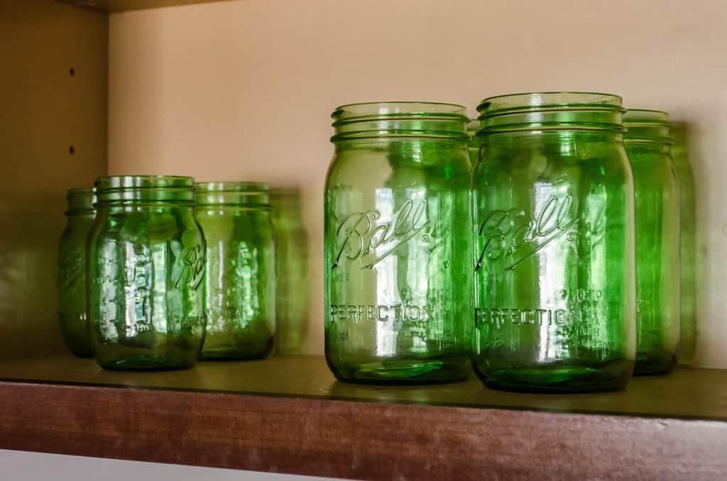 photo of green mason jars in the kitchen cabinet