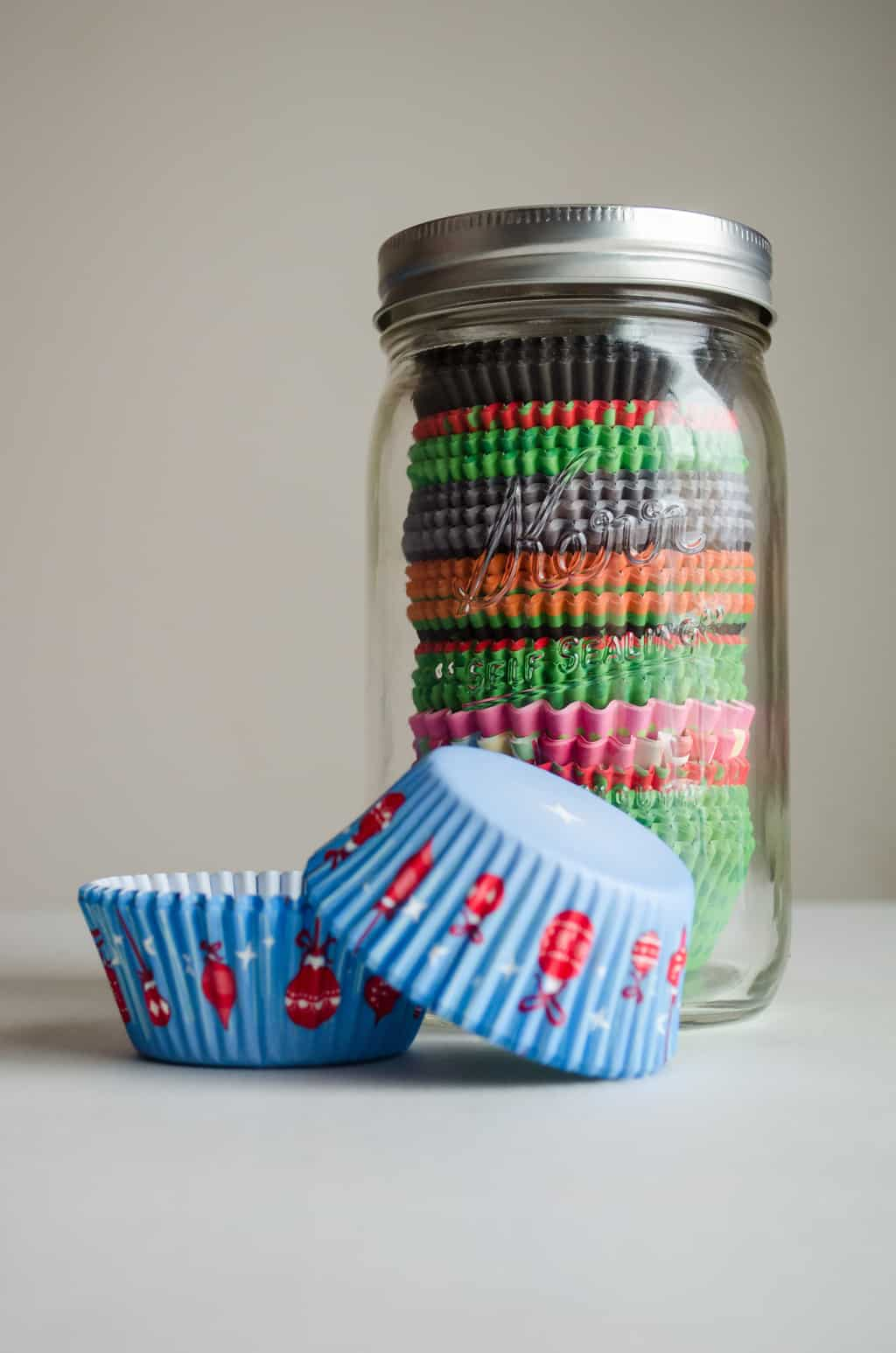 photo of mason jar with cupcake liners inside on a table
