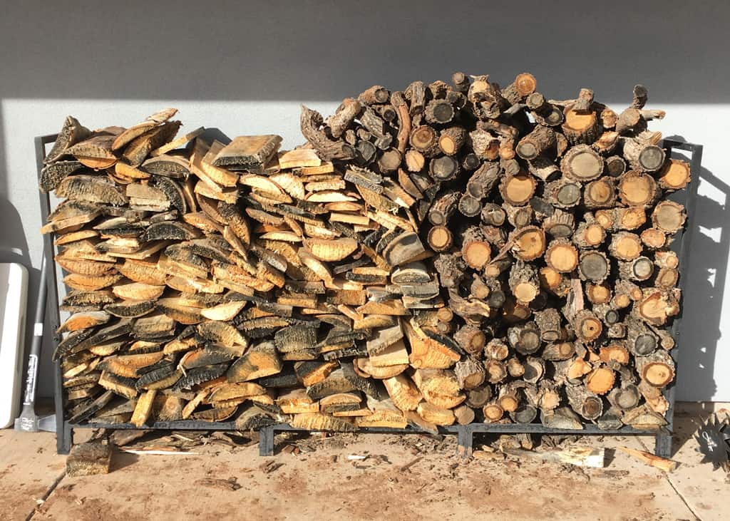 a stack of wood for a wood stove