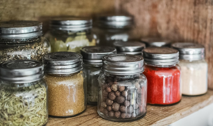 food in jars on a shelf