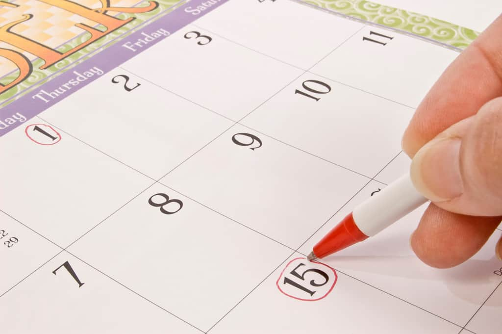 photo of a calendar with a date circled with a red pen
