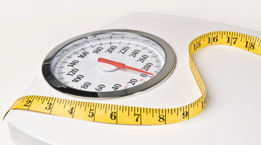 a weight scale with measuring tape