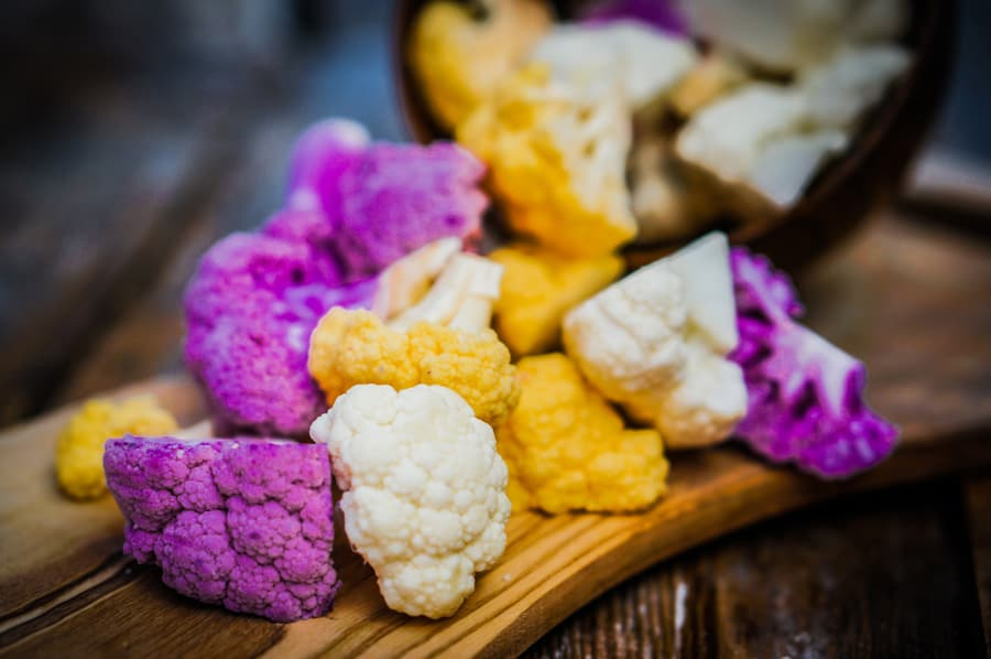 white, yellow and purple cauliflower florets