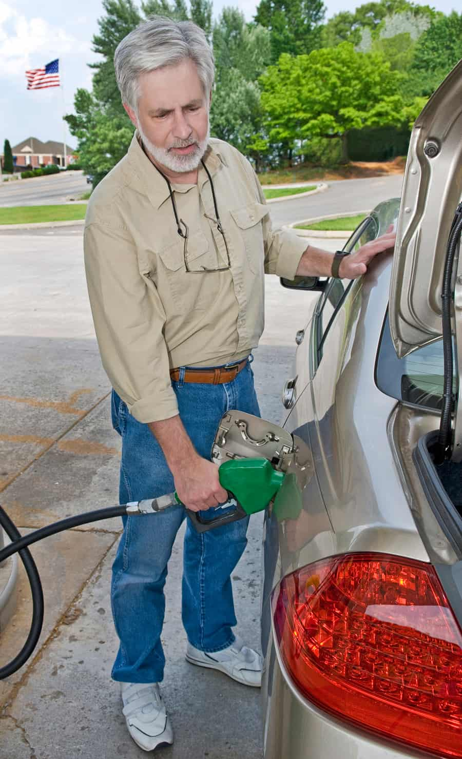 a man pumping gas
