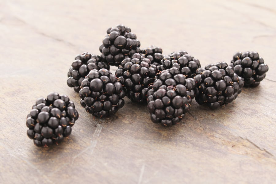 blackberries on a wooden table