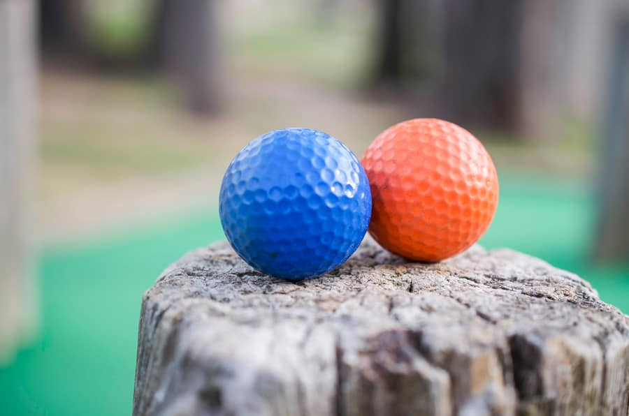 2 golf balls on a stump