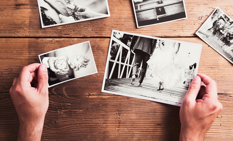 black and white photos on a wooden background