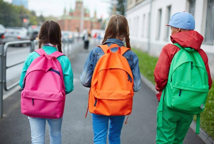 kids with bright colored backpacks