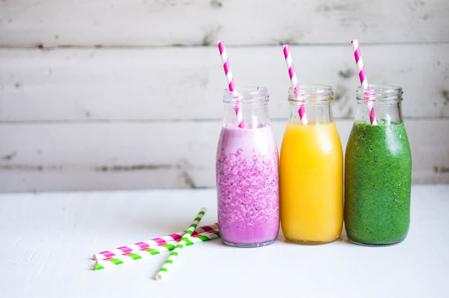 smoothies in a glass jar on white background