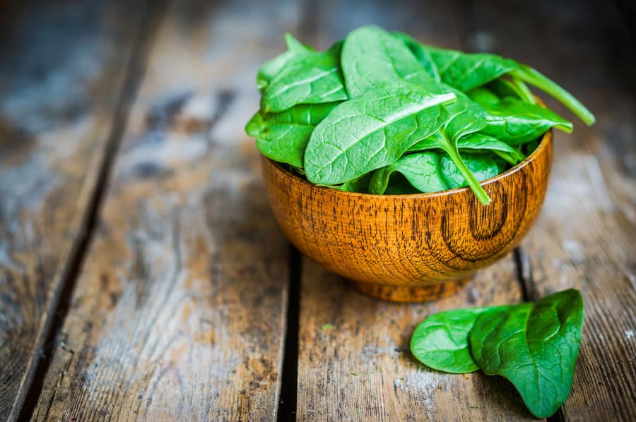 spinach in a wooden bowl
