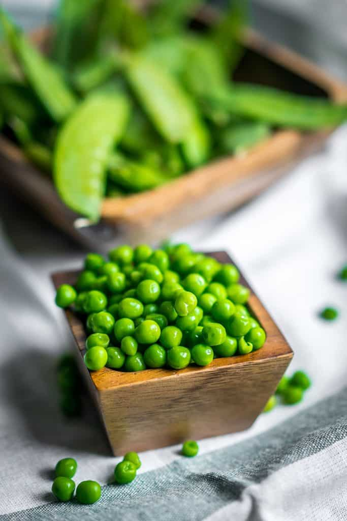 peas in a wooden bowl