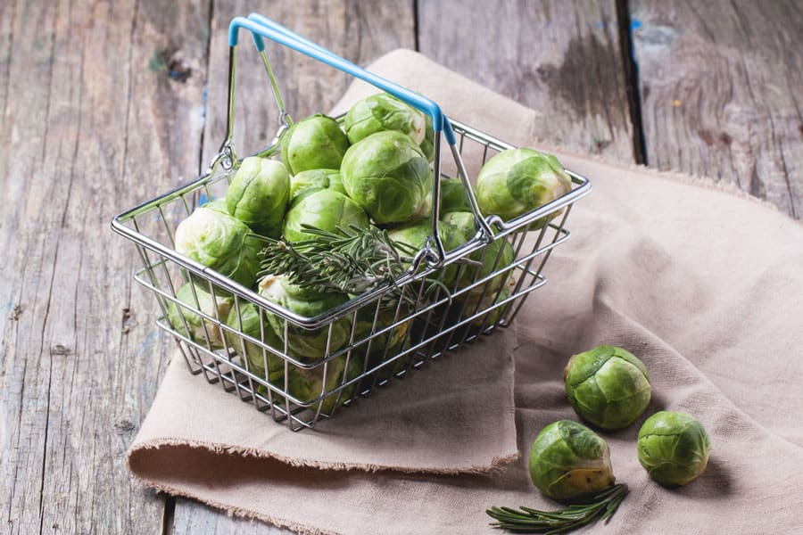 brussel sprouts in a wire basket