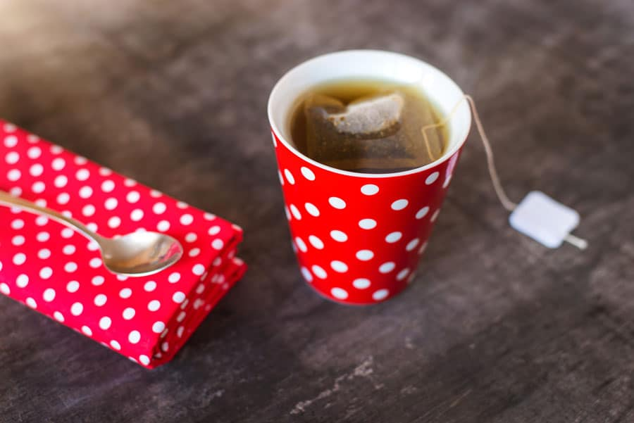 polka dotted mug with tea