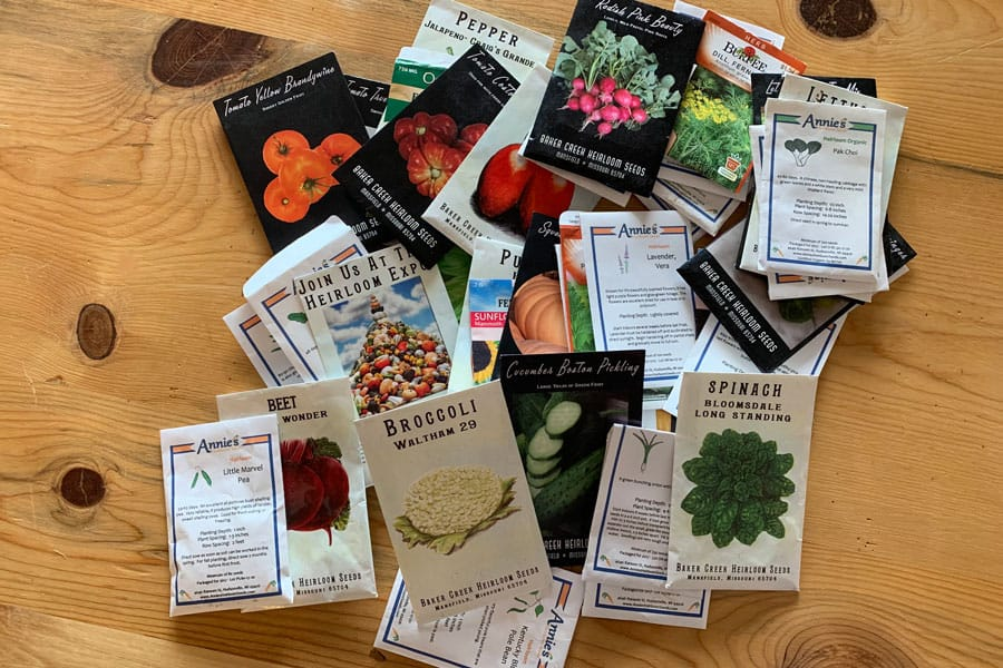 seed packets on a wooden table
