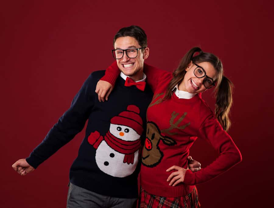 nerdy boy and girl with holiday sweaters on