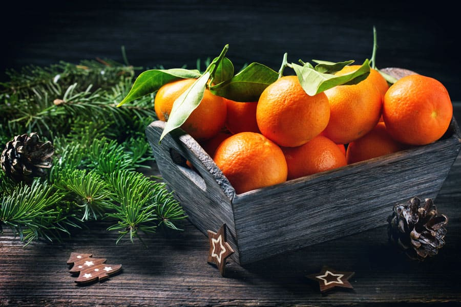 tangerines on a wooden background
