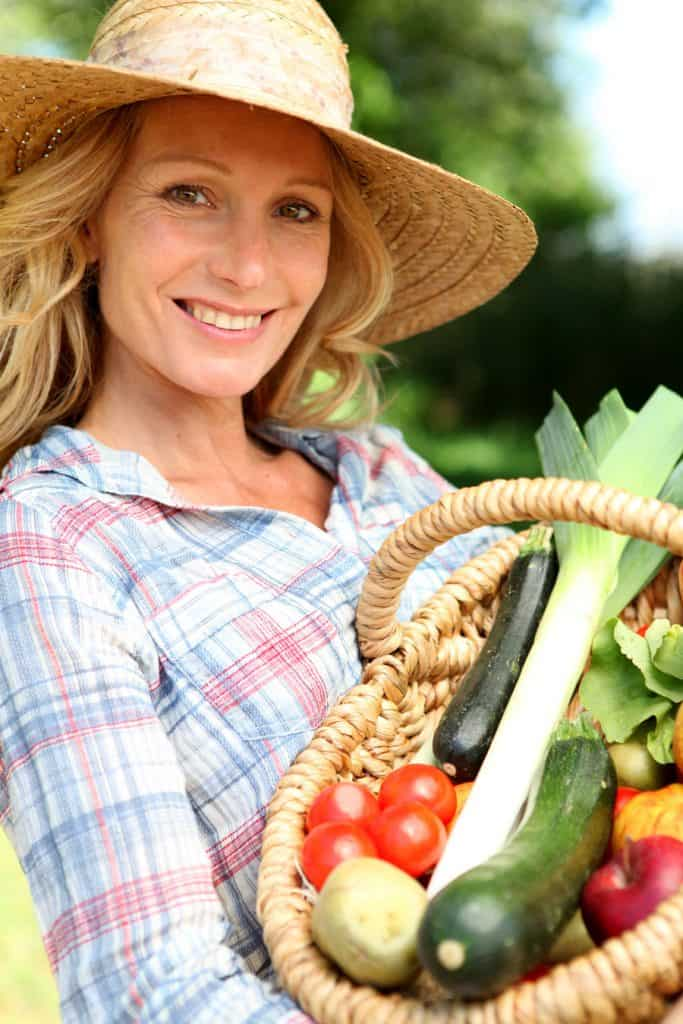woman holding basket of produce