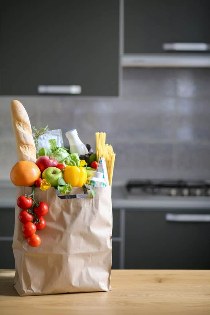 bag of healthy groceries on kitchen counter