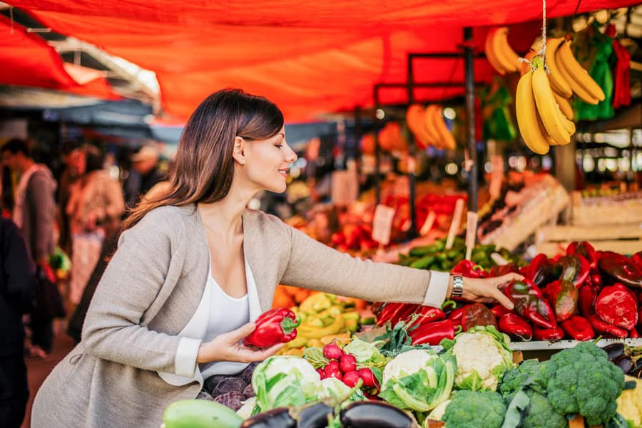 woman shopping for produce in market